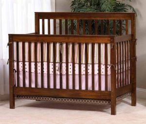 Economy Crib shown in brown maple wood